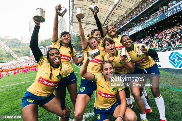 The Brazil team celebrate after winning the HSBC World Rugby Women's Sevens Series 2020 Qualifier on day one of the Cathay Pacific/HSBC Hong Kong...