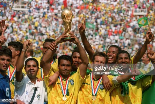 The Brazil team celebrate with the trophy