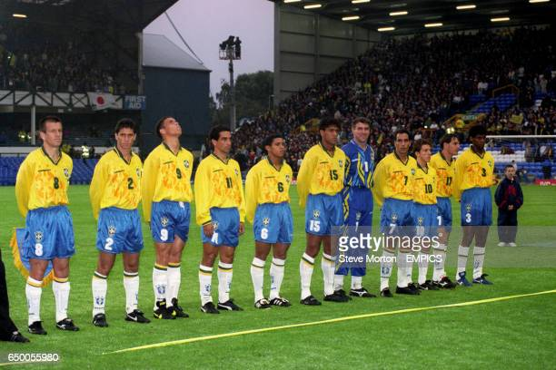 The Brazil team line up for a team photo