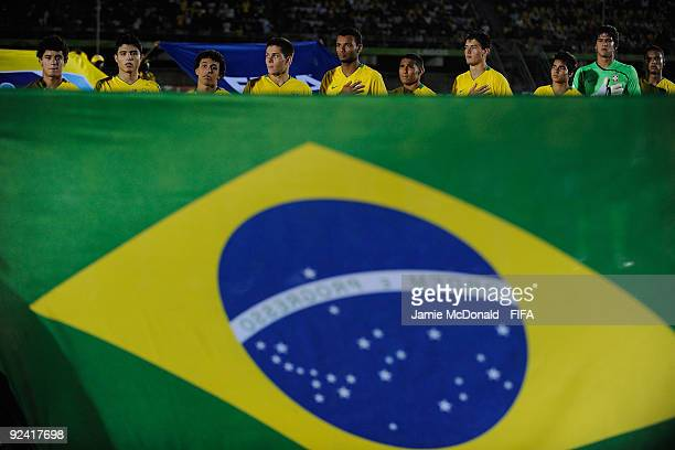 The Brazil team line up for the national anthems during the FIFA U17 World Cup match between Brazil and Mexico at the Teslim Balogun Stadium on...