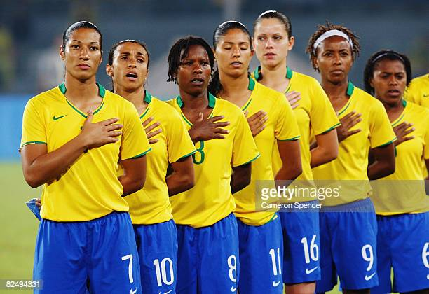 The Brazil team line up for the national anthems prior to kickoff during the Women's Football Gold Medal match between Brazil and the United States...