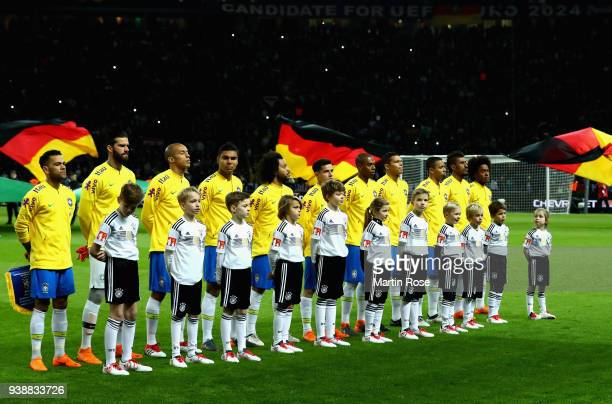 The Brazil team sing their national anthem prior to the International friendly between Germany and Brazil at Olympiastadion on March 27 2018 in...