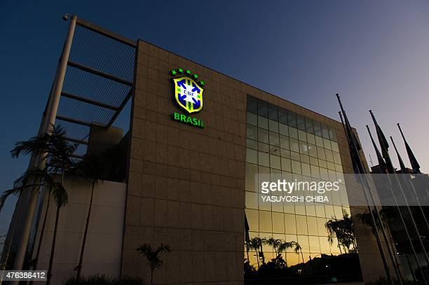 The Brazilian Football Confederation's logo shines at night on the facade of the CBF headquarters in Rio de Janeiro, Brazil, on June 8, 2015. AFP...