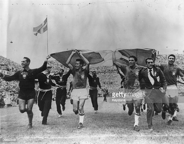 The Brazilian football team running with the Swedish flag after beating Sweden 52 in the 1958 World Cup final in Stockholm
