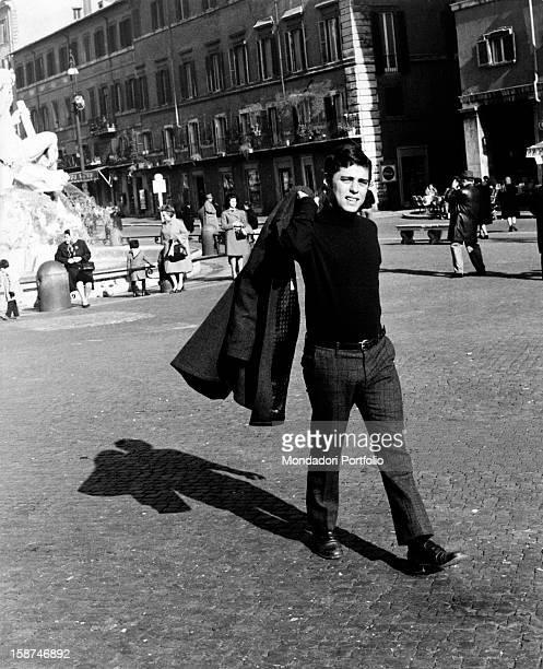 The Brazilian musician and composer Chico Buarque walking in Piazza Navona Rome 1969