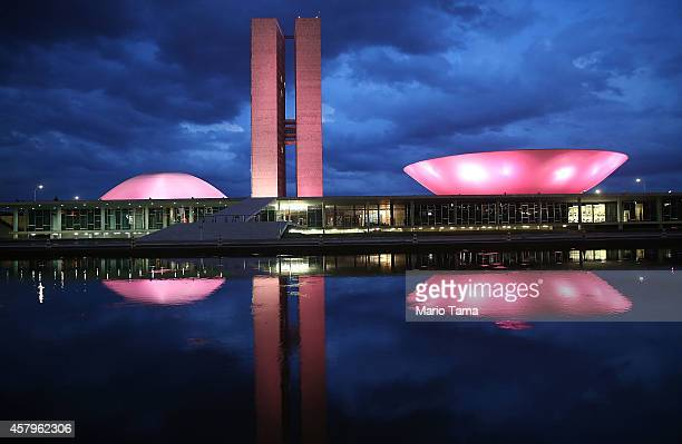 The Brazilian National Congress building is lit at dusk on October 27 2014 in Brasilia Brazil Brazil's leftwing President Dilma Rousseff was narrowly...