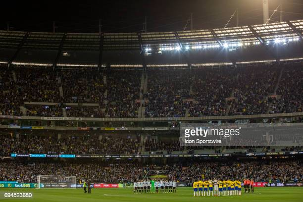 The Brazilian National Football Team and Argentinan National Football Team stand in silence in front of 95000 fans for a minutes silence during the...