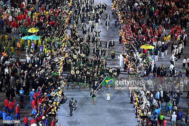 The Brazilian Olympic team enter the atheletes parade during the Opening Ceremony of the Rio 2016 Olympic Games at Maracana Stadium on August 5, 2016...