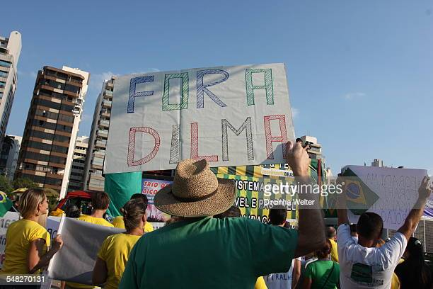 The Brazilian people on the streets to protest against the government and corruption The protesters wear green and yellow and carry flags of Brazil...