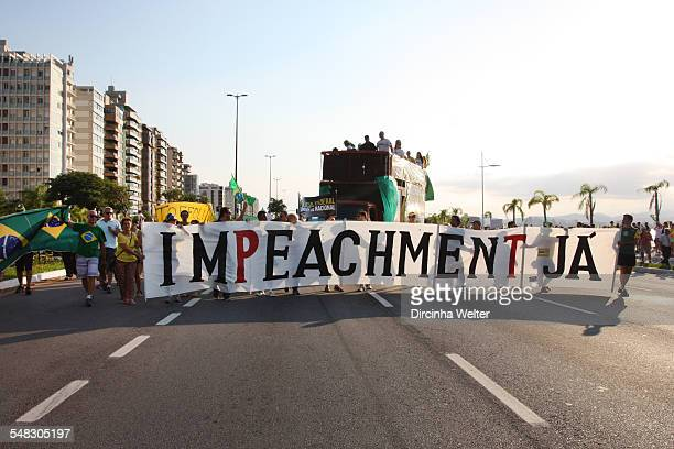 The Brazilian people on the streets to protest against the government and corruption. The protesters wear green and yellow and carry flags of Brazil...