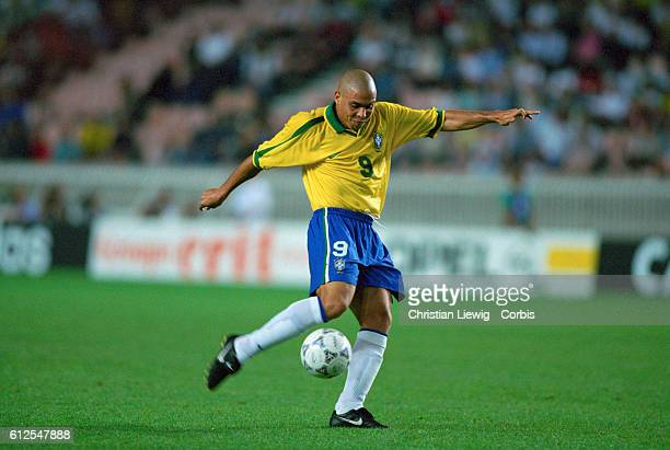 The Brazilian soccer player Ronaldo prepares to kick the ball during a French Tournament match against England Brazil went on to win the match 10