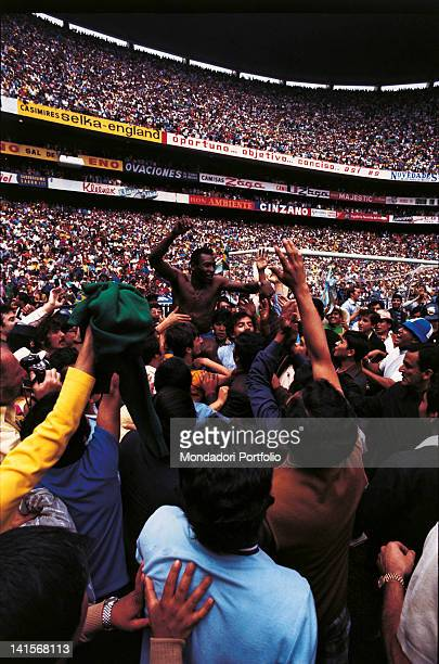 The Brazilian striker PelF is carried in triumph at the end of the match between Brazil and Italy with the final result of 41 to Brazil who were...