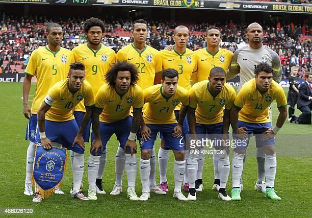 The Brazilian team Brazil's midfielder Fernandinho Brazil's striker Luiz Adriano Brazil's midfielder Souza Brazil's defender Miranda Brazil's...