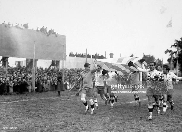 The Brazilian team led by goalkeeper Joel and team captain Preguinho parading the Uruguayan National flag around the ground to gain the support of...