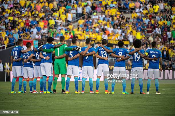 The Brazilian team observes a moment of silence for Mohammed Ali prior to the Copa America Centenario Group B match between Brazil and Ecuador at the...
