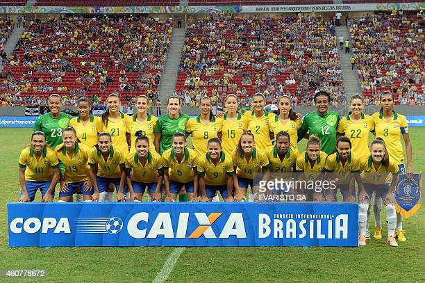 The Brazilian women's national football team poses for the press before a match of the 2014 Brasilia International Tournament at the Mane Garrincha...