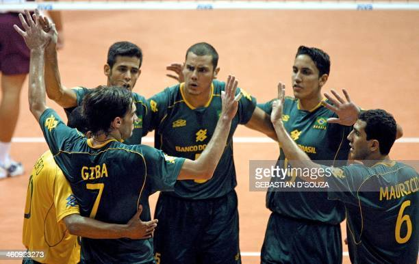 The Brazilians Giba Segio Henrique Andre y Mauricio celebrate their victory against Venezuela on September 29 2002 in the Orfeo Stadium of Cordoba...