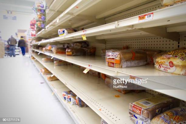 The bread isle of a Philadelphia PA grocery store is near empty as the region braces for the 'Bomb Cyclone' winter storm Grayson on January 4 2018