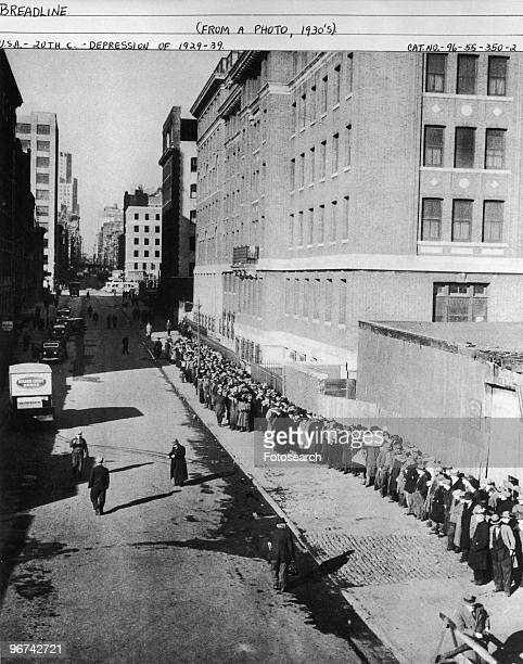 The bread line queuing for food during the Great Depression Location unknown USA circa 1930s