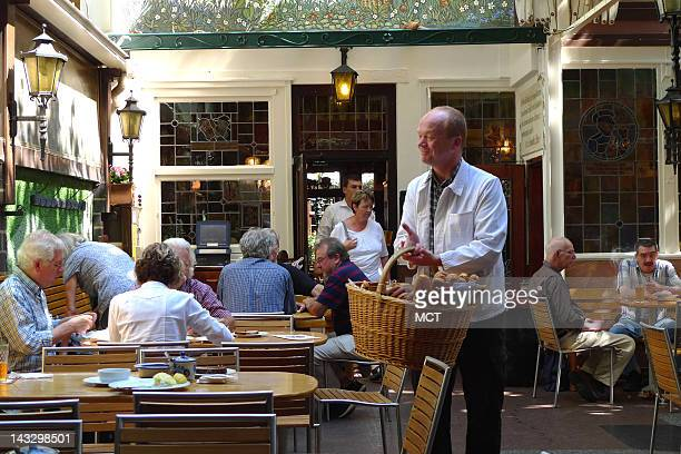 The breadman circulates among the tables at lunchtimes Zum Gemalten Haus Frankfurt