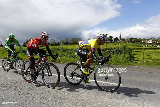 The breakaway group passes by St. Aidan's Parish Church in Saltersgrange, outside Armagh, during the third stage of the 97th Giro d'Italia from...