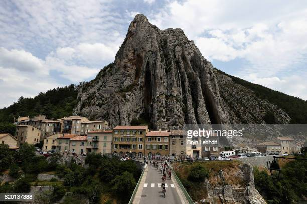 The breakaway group rides through Sisteron on stage nineteen of the 2017 Tour de France a 2225km stage from Embrun to SalondeProvence on July 21 2017...