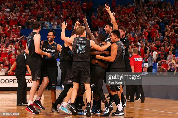 The Breakers celebrate after a three point shot by Cedric Jackson to win the game in double overtime during the NBL Rd 19 game between the Perth...