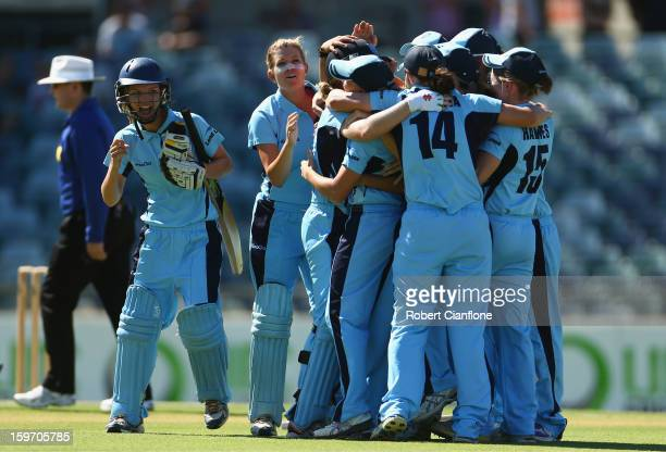 The Breakers celebrate after they defeated the Fury during the women's Twenty20 final match between the NSW Breakers and the Western Australia Fury...