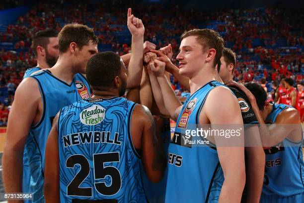 The Breakers huddle and celebrate after winning the round six NBL match between the Perth Wildcats and the New Zealand Breakers at Perth Arena on...