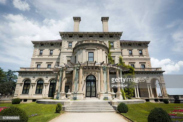 the breakers mansion at cliff walk in newport, rhode island - newport rhode island stock pictures, royalty-free photos & images