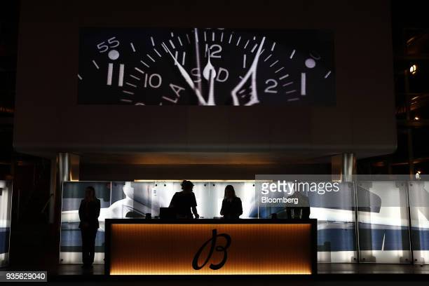 The Breitling luxury wristwatch booth stands illuminated during the opening day of the 2018 Baselworld luxury watch and jewelry fair in Basel...