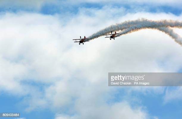 The Breitling Wingwalkers in Stearman Biplanes perform loops and rolls at the National Museum of Flight airshow East FortunePicture date Saturday...