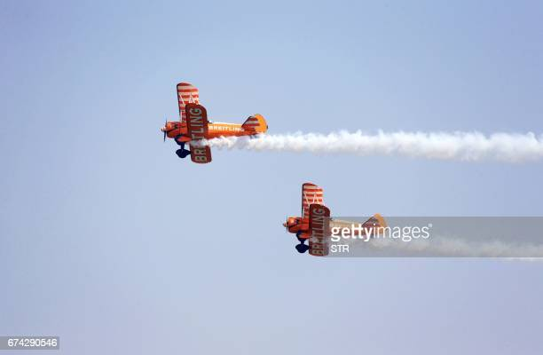 The Breitling Wingwalking team performs at the Airshow Zhengzhou 2017 in Zhengzhou central China's Henan province on April 28 2017 The airshow takes...