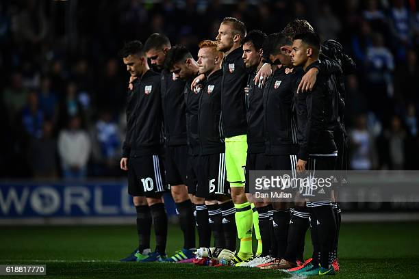 The Brentford team observe a two minute silence ahead of Remembrance Sunday during the Sky Bet Championship match between Queens Park Rangers and...