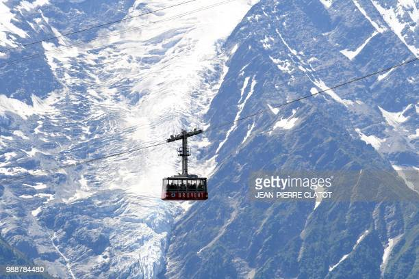The Brevent funicular makes its ascent in front the Bossons glacier, on July 1 in Chamonix, the French Alps.