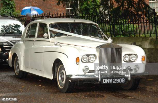 The bridal car at the wedding of Ant McPartlin and Lisa Armstrong at StNicholas Church in Taplow Buckinghamshire Picture date Saturday July 22 2006...