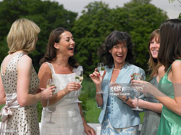 the bride and female wedding guests - wedding guest stock pictures, royalty-free photos & images