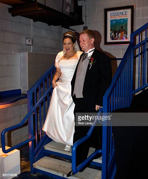 The bride and groom are introduced at their reception held at The House of Dereon on October 10 2008 in Houston Texas The Survivor Foundation a...