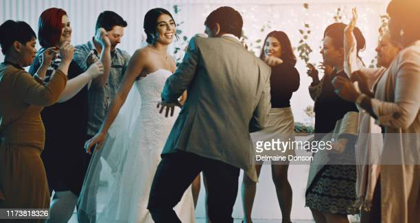 the bride and groom are taking over the dance floor - loyalty stock pictures, royalty-free photos & images
