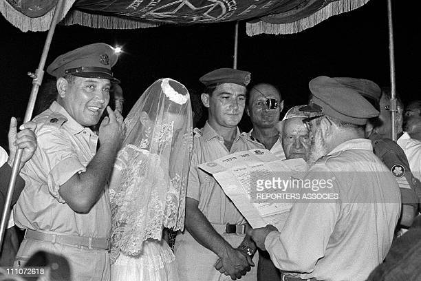 The bride and groom Moshe Dayan David Ben Gurion at the marriage of YDayan in Israel on July 22 1967