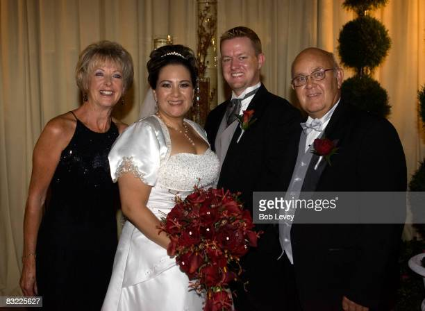 The bride and groom with the brides parents on October 10 2008 in Houston Texas The Survivor Foundation a notforprofit organization founded by...