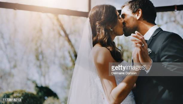 the bride is his to kiss - wedding stock pictures, royalty-free photos & images