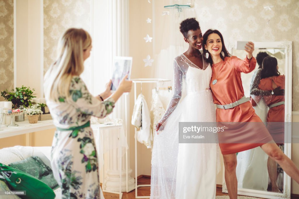 The bride is trying out her wedding dress : Stock Photo