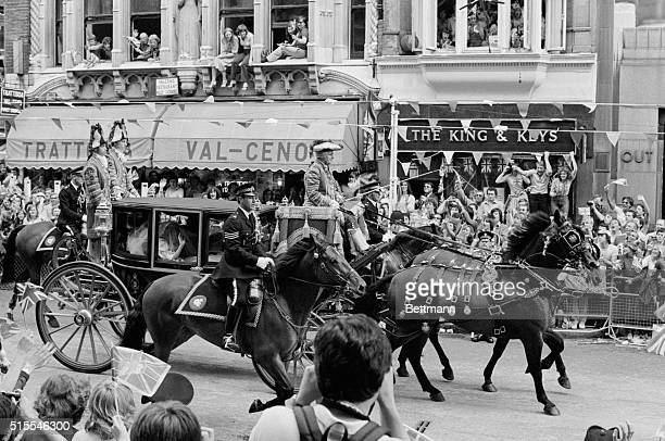 The bride, Lady Diana Spencer, in the Glass Coach passing through Fleet Street to St. Pauls Cathedral for her wedding to Prince Charles.