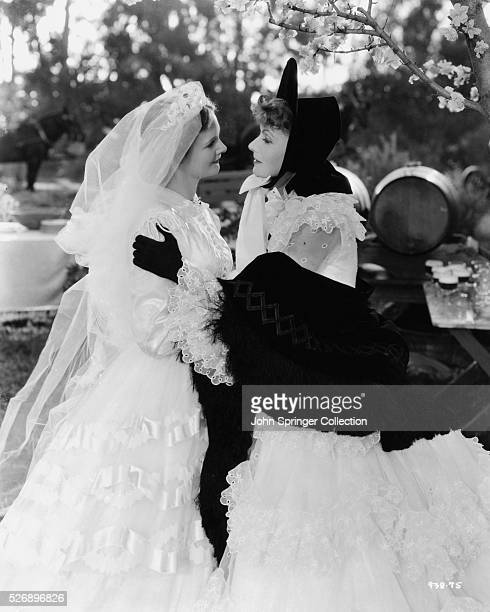 The bride Nichette receives well wishes from Marguerite Gautier in the 1936 film Camille