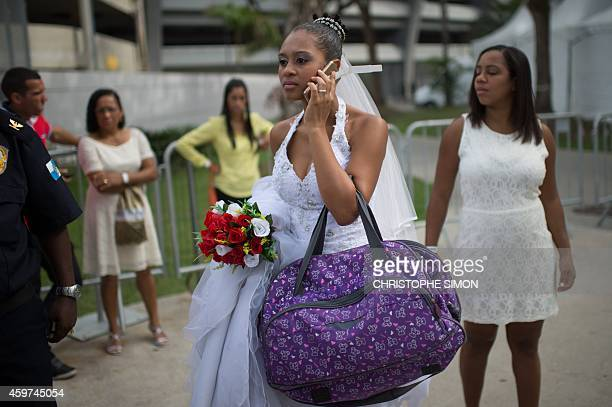 The bride of one of the 1960 couples getting married in a collective civil marriage ceremony at the Macazinho stadium next to the famous Maracana in...