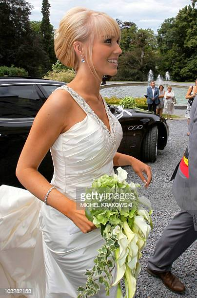 The bride, Patricia Zeevaert, arrives at her wedding with Belgian cyclist of Omega Pharma-Lotto, Philippe Gilbert at the castle in Harze, on August...