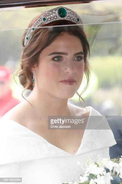 The bride Princess Eugenie of York arrives by car for her Royal wedding to Mr Jack Brooksbank at St George's Chapel on October 12 2018 in Windsor...