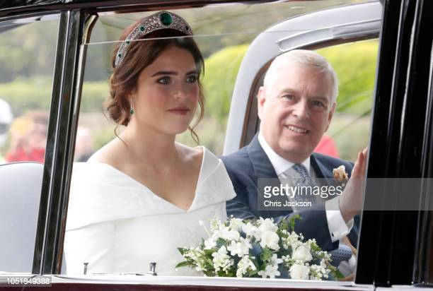 The bride Princess Eugenie of York with her father Prince Andrew Duke of York arrives by car for her Royal wedding to Mr Jack Brooksbank at St...
