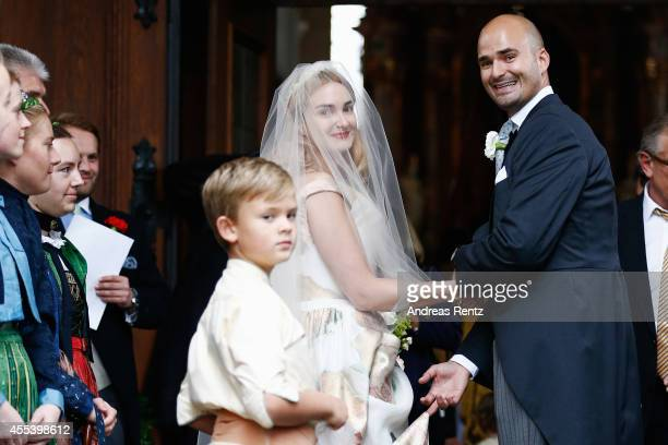 The bride Princess Maria Theresia von Thurn und Taxis is guided by her brother Prince Albert von Thurn und Taxis to the St Joseph church prior to the...